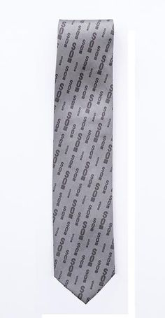 Show off your Seattle Opera pride at the opera or a night out on the town. This grey tie is 100% silk.