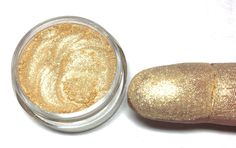 """""""All+that+Glitters+2.0"""" Shimmering+Mineral+Eyeshadow+ Loose+Powder+  A+beautiful+,+soft+golden+base+enhanced+with+soft,+shimmering+golden+sparks  Stunning+as+a+lid+or+highlight+shade!+  Sold+in+a+fully+packed+TEN+gram+jar+with+sifter+   Tip:+To+achieve+maximum+color+payoff,+apply+over+..."""