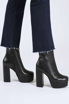 These sky-high platform boots are a black-boot must have. We love the ankle cut, perfect for wearing with cropped frayed jeans. #Topshop