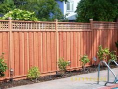 Get tips on designing attractive privacy fencing. Plus learn the right height for a privacy fence. #PrivacyFenceIdeas #PrivacyFenceIdeasWood #PrivacyFence #FenceIdeas