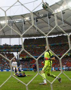 and it's in the net!!! Van Persie scores...