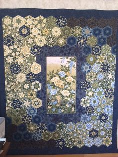 One Block Wonder.  I was inspired by a quilt I saw at a quilt show.  This was a lot of piecing (not my favorite thing), but once I had the hexies together, my husband and I spend over a month just moving them around on my design wall before assembling the quilt.  That was as much work as doing the piecing! Used an edge to edge for the quilt (excluding the center panel which I free motioned outlining everything).November 2015, quilted January 2016.