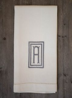 These elegant guest towels are made of 100% white linen and finished with intricate hemstitch detail.  Size 18 x 24 in  Towel fabric color: - White  Embroidery thread - Grey OR - Taupe  Embroidery design - Box Style Monogram (please indicate the letter that you want and the color of thread)  I invite you to visit my store for more selections: https://www.etsy.com/ca/shop/MGmaison?ref=hdr  Please aware that color may look a bit different on certain computer screen...
