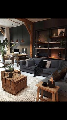 A industrial living room with a wall-mounted shelving unit, grey upholstery, wooden chests and a stool and workspace in the corner. room decor industrial Masculine Industrial Living Room With A Wall-Mounted Shelving Unit Industrial Interior Design, Home Interior Design, Interior Styling, Industrial Bedroom, Industrial Interiors, Industrial Furniture, Industrial Living Rooms, Interior Design Living Room Warm, Industrial Decorating