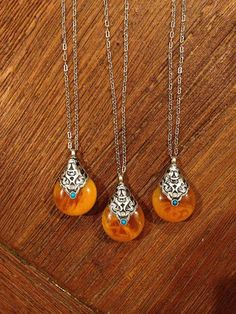 This is so beautiful!! I would love this:) Orange Stone Necklace with Real Torquise accent by HerMadeUpWorld