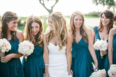Teal bridesmaid dresses contrast greatly with their soft colored bouquets. // Photo by : http://troygrover.com