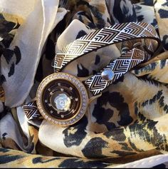 Wrap shown with locket containing our white rose charm and Geo black nesting bubbles. Eye catching!