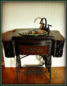 """What a great idea for an old sewing machine base.  The base was unusable for the machine and the case was repaired by the son of the owner who created this """"new"""" vanity."""