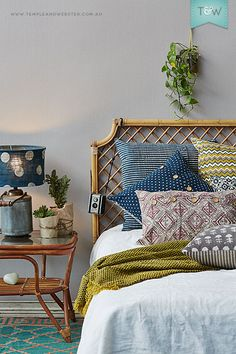 gorgeous linens and mix of colors and patterns with rattan