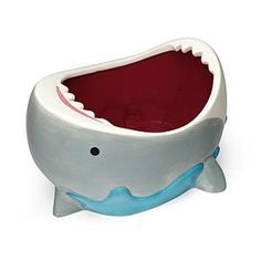 Shark Attack Bowl Just when you thought it was safe to go back in the kitchen - SHARK ATTACK BOWL! There are so many uses for your Shark Attack Bowl. Toss in a bunch of goldfish crackers. Fill it with blood-red salsa with a tortilla chip sticking out at a jaunty angle, like a fin! Cannibal shark! What are you going to do with yours?