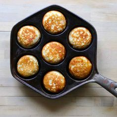Aebleskiver are traditional Danish pancakes that are cooked in a special stovetop pan with half-spherical molds.