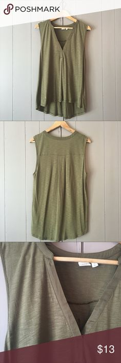 """NWOT Olive green vneck flowy high low tank This is an adorable tank that has never been worn. Lightweight and also perfect for layering. It's also stretchy. Armpit to armpit is 20"""". Length: Front-25""""; Back-28"""". GAP Tops Tank Tops"""
