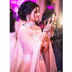 Fatima Soomar Bridal Makeup for indian wedding on lehenga Photo of Messy bun with loose curls for sister of the bride Bridal Hairstyle Indian Wedding, Bridal Hair Buns, Indian Wedding Outfits, Indian Weddings, Hair Wedding, Wedding Dresses, Messy Bun Wedding, Real Weddings, Bride Indian