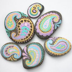 Spruce up some backyard stones with pastel paint pens and an easy paisley motif!