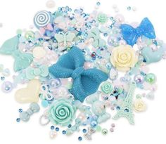 The picture shows a sample of our current stock in the chosen theme, and is representative of the types of embellishments you may receive in your pack. #Craft #DIY