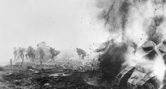 Hell breaks loose in Flanders, in one of the most graphic of all war pictures. This photograph of actual combat shows a British tank being wrecked by a shell and bursting into flames. Another tank is crashing through barbed wire, with British infantry accompanying. The ground is strewn with untenanted helmets and ownerless guns. Almost under the burning tank is a fallen soldier.