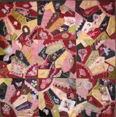 "I have put all the blocks together, now I just need to add a border, backing and binding. I'm calling this my ""CQGatherings Memory Quilt"" as it is made up of charms, beadeds, ribbons,and little surprise RAOK gifts I received from my online group"