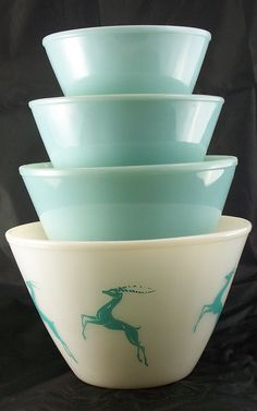 "Anchor Hocking Fire-King bowls, including the ""Gazelle"" bowl, a pattern that was only made as a 4 quart splash-proof bowl. NOT Pyrex, but would love to have them anyway."
