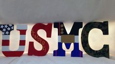 USMC letters that you can hang on your wall or place on a shelf. The letters are wooden, hand cut and hand painted. Each letter has something to Marine Tattoo, Usmc Love, Marine Love, Marine Sister, Deployment Party, Military Party, Going Away Parties, Marines Girlfriend, Semper Fi