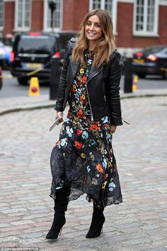 Floral fancy:Louise Redknapp, 42, seemed to enjoy taking a break from work as she attended the Preen By Thornton Bregazzi Autumn/Winter '17 show at the QEII Centre on Sunday