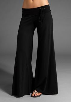 Waist is made of lycra is black and has 2 hanging ribbons of the same color, the pants are flared and costs 324