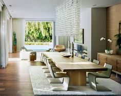 Wood table + contemporary chairs + a chandelier with personality  The New Formula for Modern Dining - The Interior Collective