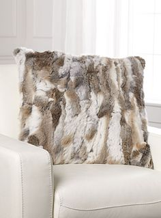 Exclusively from Simons Maison   Fashionable and luxurious decorative touch that dresses up and warms any room in the house with rich and warm rabbit fur on a velvety faux-suede backing.   - Detachable zip cover  - Oversized square shape, 60 x 60 cm  - Matching rectangular cushions and throws also available