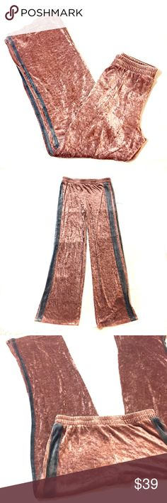 "Free People Movement Velour Track Pants Size M Free People Movement Women's Velour Track Pants Size M Gently worn, no rips or stains.  The inside shows a little wear as pictured but the outside is in great shape. These pants are amazingly soft.  They're a deep rust-rose pink shade.  There is a sporty gray velour stripe on the sides.   Side slits at the hem.  INSEAM:  32""  WAIST MEASURED FLAT ACROSS:  15""   RISE:  11"" Free People Pants Track Pants & Joggers"