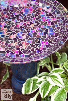 Mosaic tile birdbath using recycled DVDs