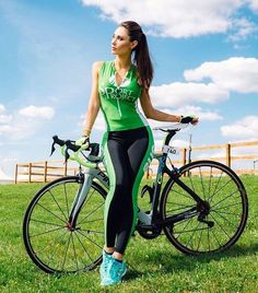 Women in tights... Women on bikes... — Green and black biking outfit