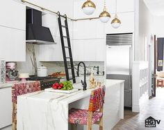 While most people might associate these sort of ladders with libraries, Genevieve decide to add extra cabinets and a detachable ladder for even more storage.                   Source: HGTV
