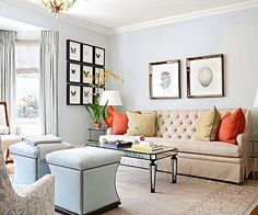 Bring the outside inside by painting your walls a soft, dreamy shade of sky blue. In this living room, bright shades of buttery yellow and fiery orange echo colors found in flowers and sunlight. Reflective surfaces such as the coffee table and picture frames enhance the plentiful sunlight streaming in from outdoors.