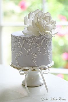 tiny silver and white wedding cake -- just right for an intimate family wedding, courthouse wedding or elopement