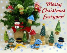 Christmas Corkers - free crochet ornament patterns by Moji-Moji Design. Includes snowmen, little elf, toadstool and xmas tree.