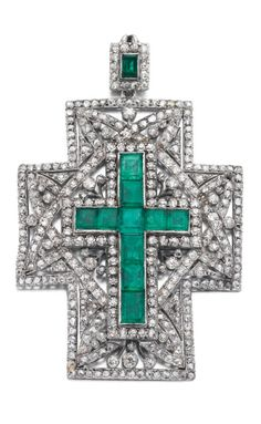 An antique emerald and diamond pendant, early 20th century. Designed as a cross set with step-cut emeralds, circular-, single-cut and rose diamonds, the pendant hoop similarly set.