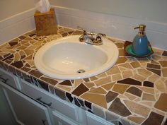 Kitchen counter makeover:  broken tiles, adhesive, grout & sealer