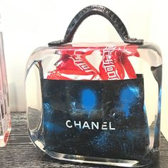 #Artist Fred Allard features popular brands such as Chanel and Coca-Cola to his #glass sculpture bags! How does he do it? No idea! #Genius #wynwoodlab #wynwood #art #home #decor