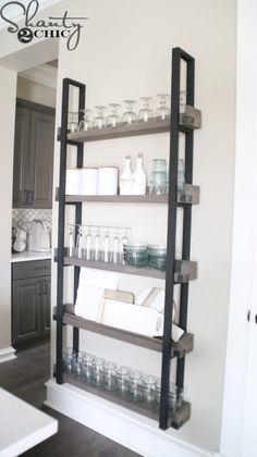 Add character to a blank wall with this DIY Floating Plate Rack. It makes a statement and has tons of storage. Easy build with FREE Plans and how-to video!
