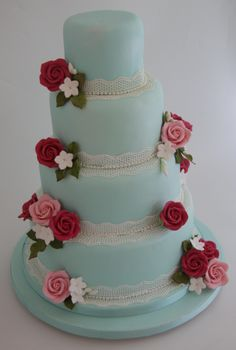 tiffany blue wedding cake with pink flowers and lace accents