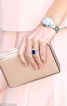The Duchess wore a silver watch and her £1 million sapphire and diamond engagement ring...