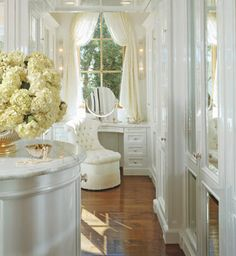 White dressing room with mirrored cabinetry