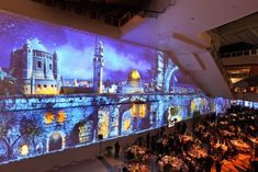 During dinner, guests were immersed in a series of large-scale projections that portrayed Jerusalem scenes. The projections slowly and subtly transitioned from day to night over the course of the meal, surprising guests.  Photo: Nadine Froger Photography
