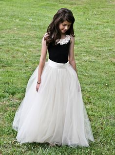 Long tulle skirt via Ets We could do just skirts like this with tops or make it one piece and add sleeves? I really like this.