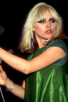 Debbie Harry, 70s/80s iconic rock chick with trademark peroxide blonde hair. It was darker underneath at the back. She said in an interview that this was because she did it herself and couldn't reach that part