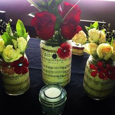 I made Mason jars with vintage music sheets, lace, twine, and flowers for bridal shower centerpieces.