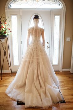 Champagne colored wedding dress on beautiful Justin Alexander bride!