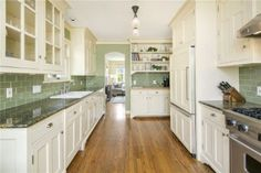 Kitchen, like green tile with white, nice cabinets. Green Lake 1344 N 78th