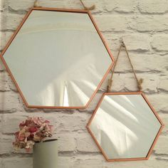Copper hexagonal shaped mirrorBeautiful on-trend hexagonal shaped copper mirror with jute rope. Hang in the hallway, bathroom or bedroom to bring a metallic vibe to your home whilst the jute rope will add a nautical twist.  A really lovely mirror that will look great on its own or paired together as a mixed set.  Small and Large sizes availableCopper Plated, Mirrored glassSmall (W20 x H17.5 cm) Large (W30 x 26.cm)