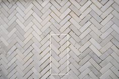 Young House Love |   How To Install A Marble Herringbone Tile Backsplash In The Laundry Room