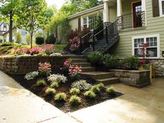 Pretty landscaping for a sloped front yard